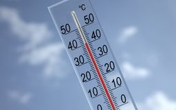 Thermometer on sky background showing 40�c Stock Photo