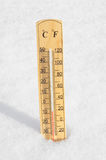 Thermometer in the snow Stock Images