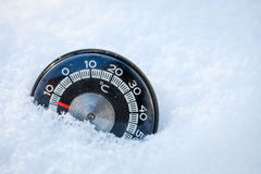 Thermometer in the snow Stock Photo