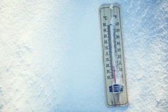 Thermometer on snow shows low temperatures under zero. Low temperatures in degrees Celsius and fahrenheit. Cold winter weather twenty under zero stock image