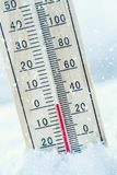 Thermometer on snow shows low temperatures zero. Low temperature royalty free stock photo