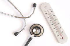 Thermometer with stethoscope Royalty Free Stock Image