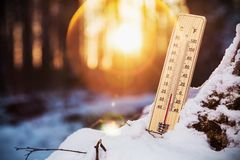 Thermometer with sub-zero temperatures. In the winter forest royalty free stock photography