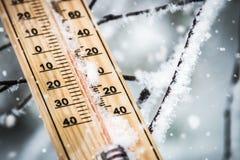Thermometer with subzero temperature stuck in the snow stock photo