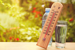 Thermometer on summer day showing near 45 degrees. Thermometer on summer day showing high temperature near 45 degrees royalty free stock photos