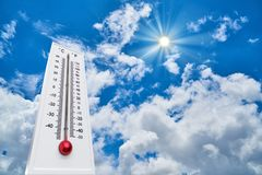 Thermometer Sun high Degres. Hot summer day. High Summer temperatures stock photography