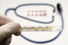 Thermometer symbolizing fever Royalty Free Stock Photo