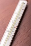 Thermometer on the table Stock Photos