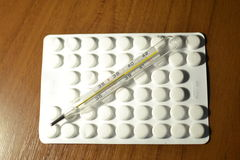 Thermometer and tablets Stock Image
