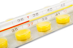 Thermometer and tablets Royalty Free Stock Photo