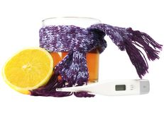 Thermometer, tea and lemon. On a white background Stock Images