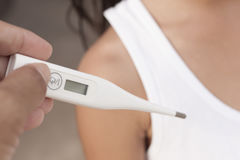 Thermometer using.Thermometer using and girl. Stock Photography