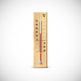 Thermometer on wooden base. Royalty Free Stock Photos