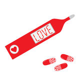 Thermometer with word love on display and heart pills. Stock Photos