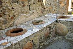 Thermopolium, Herculaneum. Ancient Taberna with storage pots in Scavi Ercolano, Campania, Italy. Thermopolia traded warm foods Stock Images