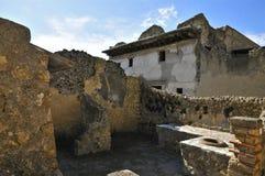 Thermopolium, Herculaneum. Ancient Taberna with storage pots in Scavi Ercolano, Campania, Italy. Thermopolia traded warm foods Stock Photos