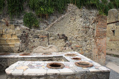 Thermopolium in Roman Herculaneum, Italy Stock Photos