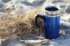 Thermos on the beach. Thermos of coffee on the beach Royalty Free Stock Photos
