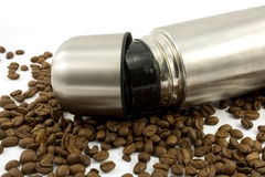Thermos and beans. Thermos and coffee beans isolated on white Stock Photo