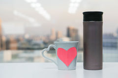 Thermos bottle with cup of love Stock Photo