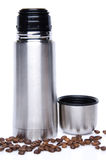 A thermos with coffee beans Royalty Free Stock Images