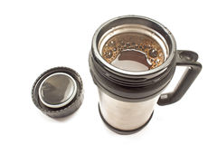 Thermos with coffee drink and lid isolated Stock Photography