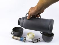 Thermos with a cup - travel, tourist set royalty free stock image