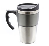 Thermos mug with handle for hot drinks. Steel thermos mug with handle for hot drinks Stock Images