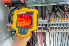 Thermoscanthermal image camera, Industrial equipment used for checking the internal temperature of the machine for preventive. Maintenance, This is checking The stock images