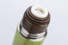 Thermosflasche-Blitz lokalisiert auf weißem Hintergrund Stockfotografie