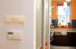 Thermostat à la maison Image stock