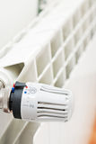 Thermostat. Radiator with radiator thermostat which is set on dot Royalty Free Stock Photos