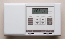 Thermostat. Closeup of energy efficient thermostat set to off for vacation or summer royalty free stock images