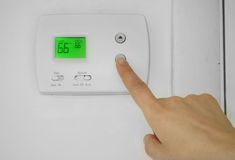 Thermostat adjust Royalty Free Stock Photos
