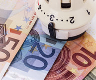 Thermostat with euro money Stock Photography