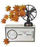 Thermostat Furnace Dial with Leaves and Fan Stock Image