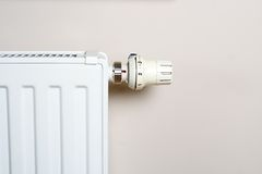 Thermostat and radiator on wall Royalty Free Stock Photo