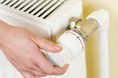 Thermostat Valve. One hand adjust thermostat valve Stock Photography