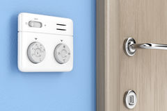 Thermostat on the wall Stock Photos