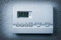 Thermostat on White Wall Royalty Free Stock Photos