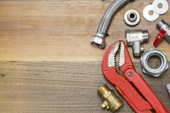 Thermostatic valve and plumber  tools on wooden background Stock Image