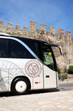 The modern bus for tourists transportation is near Byzantine city walls Royalty Free Stock Photos
