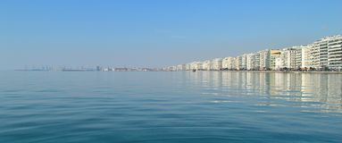 Thessaloniki embankment. And skyline reflected in the water Stock Images
