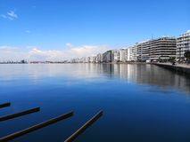 Long exposure shot of the brach of thessaloniki ,the port the buildings and the sun is making the day perfect after so much rain l royalty free stock photography