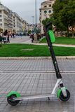 Thessaloniki, Greece - April 26 2019: A parked Lime electric Scooter rental without passenger. A green and black ride sharing Lime royalty free stock photo