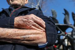 Holocaust survivor Heinz Kounio shows his tattooed serial number Stock Photography