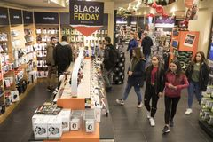 People shop inside a department store during Black Friday shoppi. Thessaloniki, Greece - November 24, 2017. People shop inside a department store during Black Stock Photography