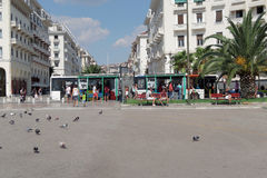 Thessaloniki, Greece - September 04 2016: Aristotelous square public bus stop. People waiting on the bus stop at Mitropoleos street on the central square of stock photo