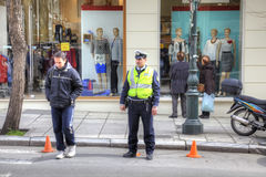 Thessaloniki. A police officer on the city street. THESSALONIKI, GREECE - March 17.2016: A policeman keeps order on a city street stock images