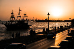 Thessaloniki Port at Dusk Time, boat passing by Stock Photos